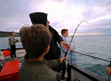 skipper helping out on an evening fishing trip on snapper charters