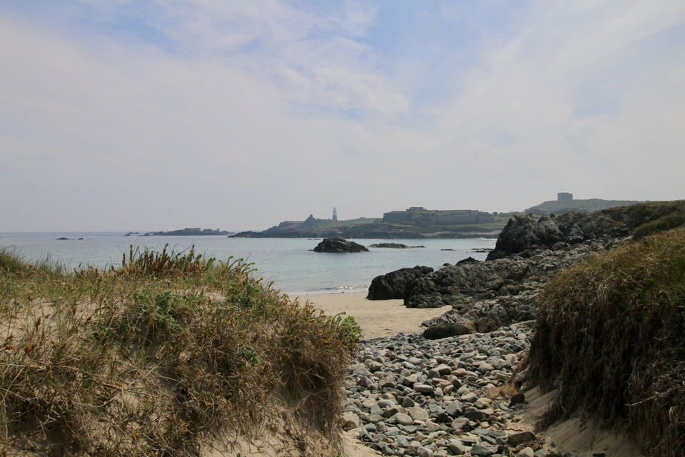 a beautiful beach on alderney next to alderney lighthouse