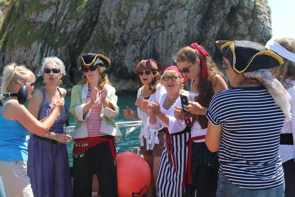 singing at durdle door on snapper charters pirate birthday party